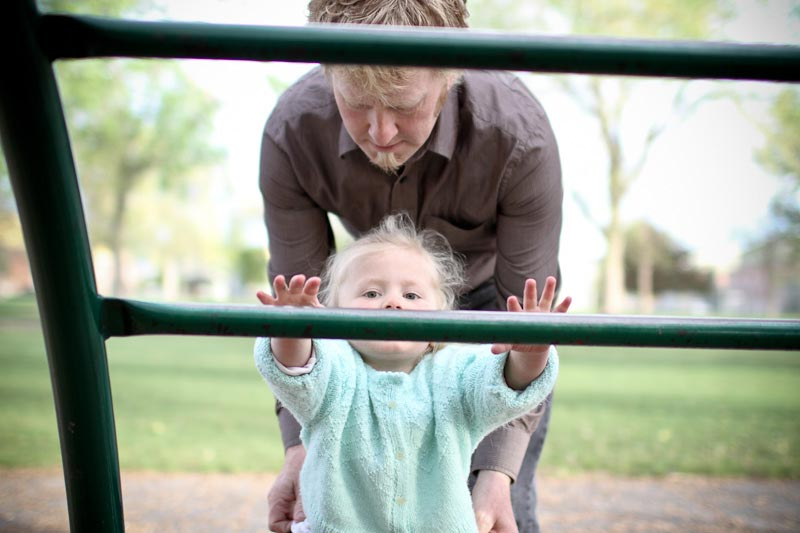 Photo of Dad helping daughter on playground
